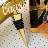 Cheers gold bottle stopper from fashioncraft