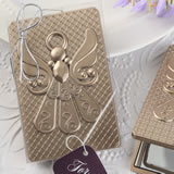 Angel themed mirror compact with a champagne gold finish