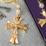 Ornate Flared cross keychain with a gold finish