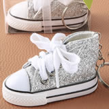 Authentic canvas mini sneaker in the classic hi-top shape with a sparkle silver glitter design