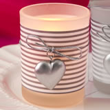 Glass Silver heart design votive candle holder with a white and silver striped design around a frost