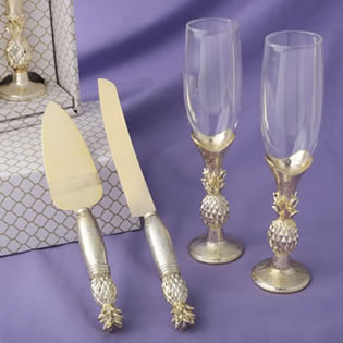 pineapple themed gold flutes and gold cake server accessory set