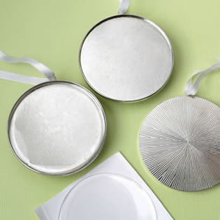 Perfectly plain Silver metal round ornament with white hanging satin ribbon