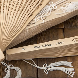 Intricately carved personalized Sandalwood fan favors from fashioncraft